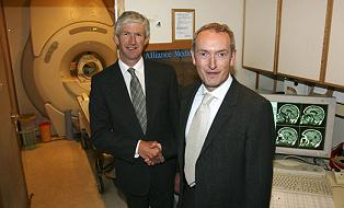 Photograph of Health Minister John Hutton MP shaking hands with Alliance Medical boss Jonathan Walsh